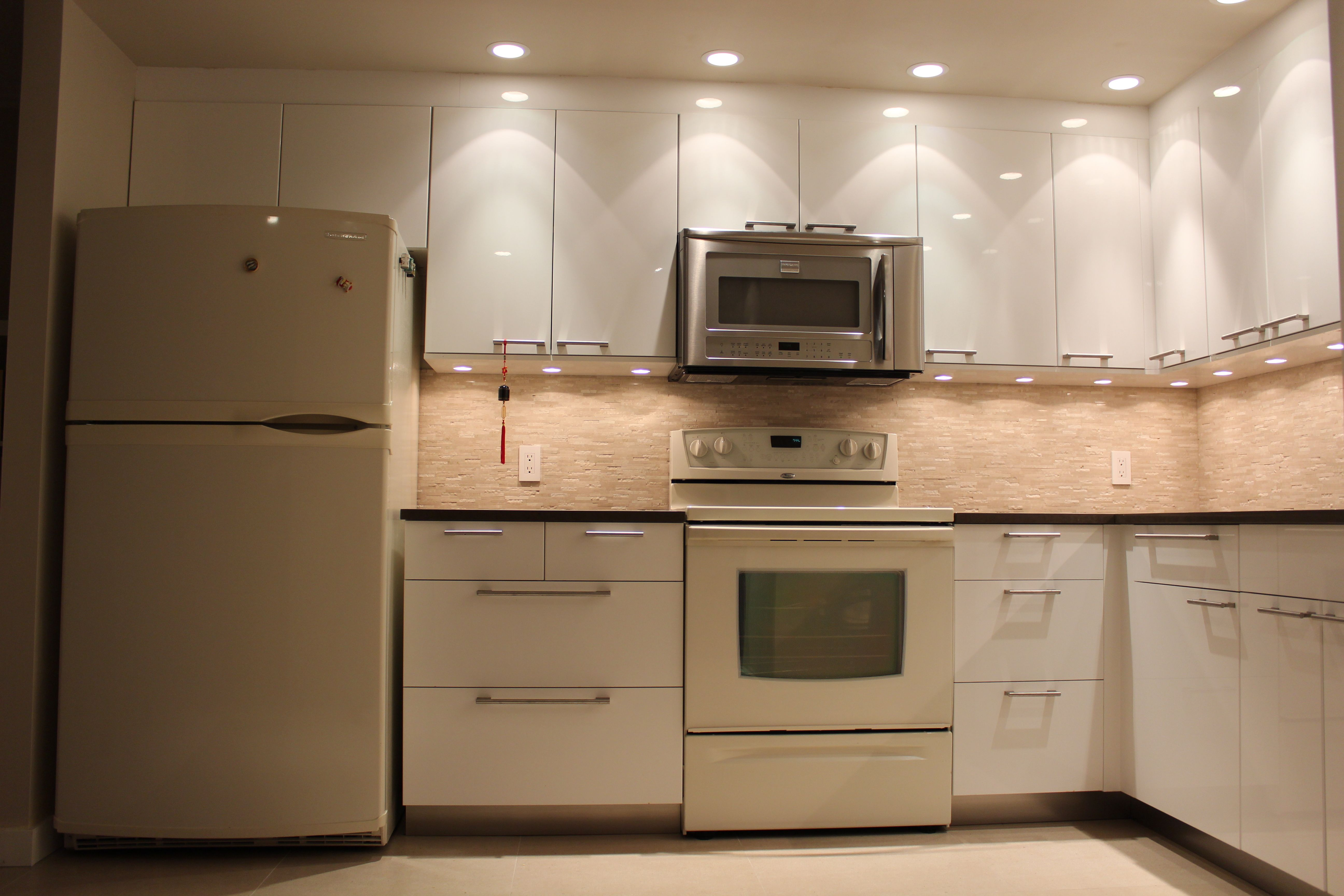 Home improvement, gloss white cabinet doors