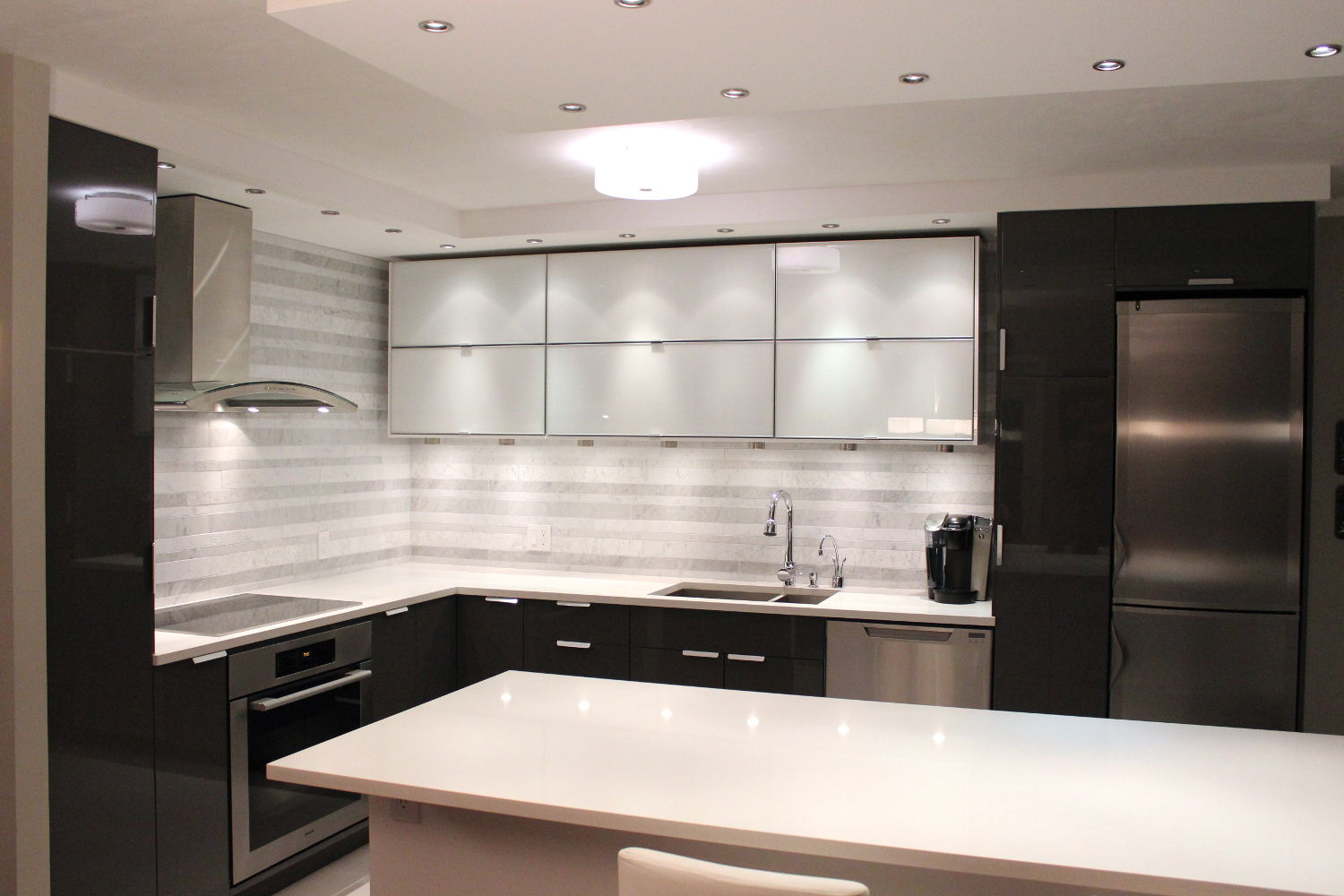 Vancouver kitchen renovation - A monochromatic marvel in False Creek
