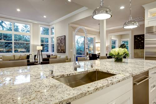 granite vs quartz - mostly white granite counter pic from shutterstock